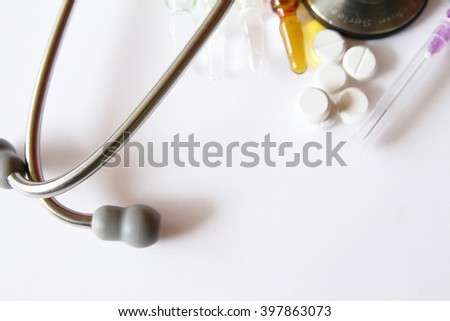 doctors stethoscope with pills - stock photo