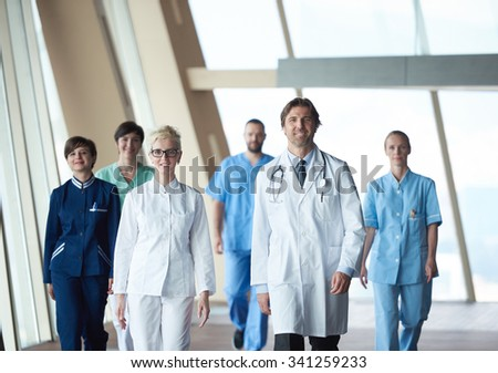doctors team walking in modern hospital corridor indoors, poeople group - stock photo