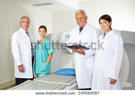 Doctors team with nurse in radiology in a hospital - stock photo