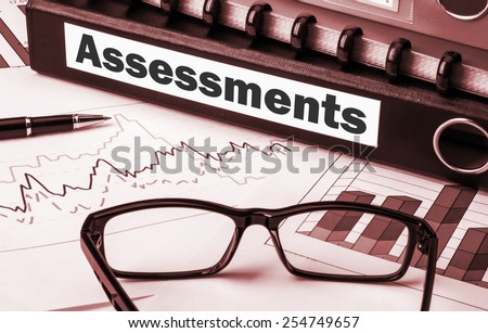 document folder with label assessments - stock photo