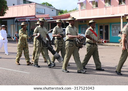 Documentary Editorial Image : Thursday Island, Torres Strait Queensland Australia â?? April 2015:ANZAC day parade with Torres Strait islander soldiers playing traditional instruments during the march.  - stock photo