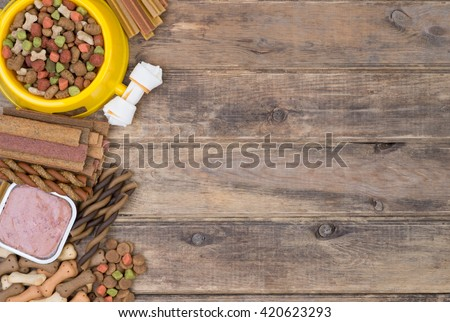 Dod food selection on wooden background with copy space, top view - stock photo