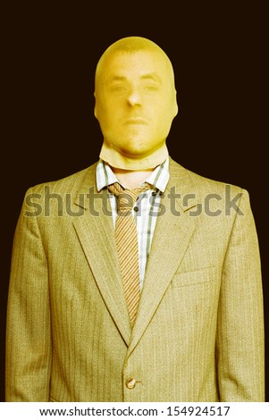 Dodgy business person of nefarious character disguised in a stocking mask as he goes about his unlawful business practices - stock photo