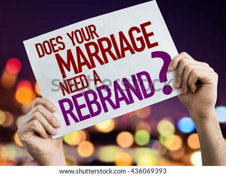 Does Your Marriage Need a Rebrand? placard with night lights on background - stock photo