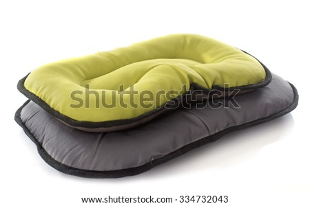 dog bed in front of white background - stock photo