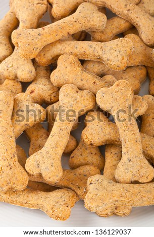 Dog biscuits on white background - stock photo