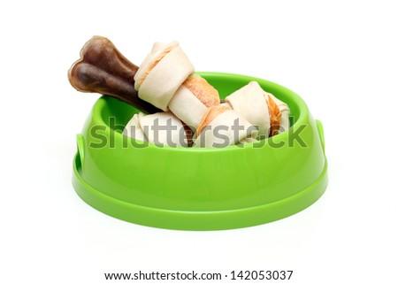 dog dish with  bones  isolated on white - stock photo