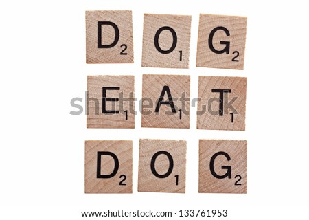 dog eat dog spelled with scrabble letters isolated on white - stock photo