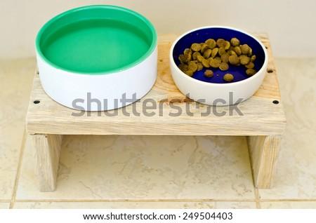 dog food bowl on the floor - stock photo