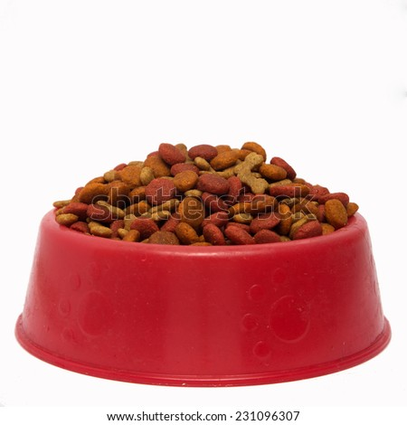 Dog food in bowl against white background - stock photo