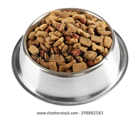 Dog food in bowl, isolated on white - stock photo