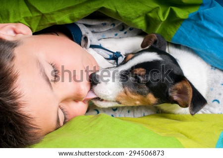 dog licking boy  - stock photo