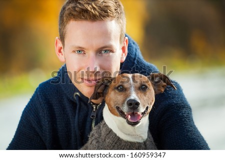 dog owner in love with his cute dog - stock photo