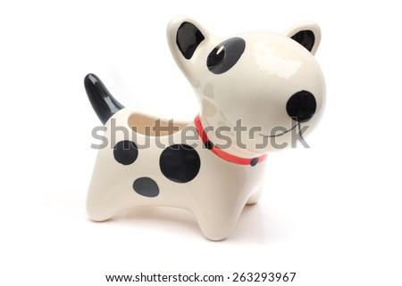 dog statue ceramic on white background - stock photo