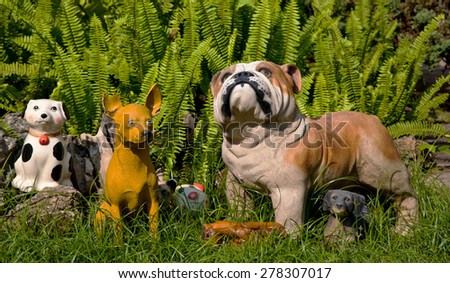 Dog statue in garden - stock photo