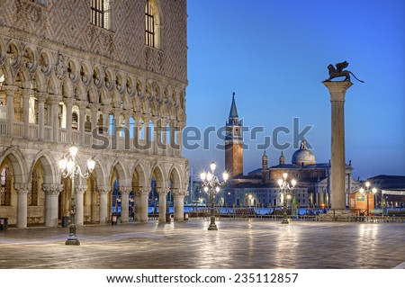 Doges Palace (Palazzo Ducale) and San Giorgio di Maggiore church in the background seen from Saint Mark square at blue hour, Venice, Venezia, Italy, Europe - stock photo