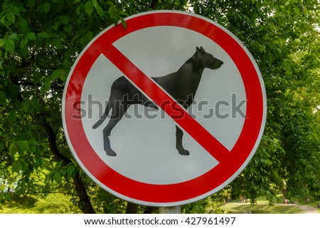Dogs prohibited sign in park - stock photo