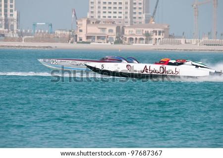 DOHA-MAR15: The Qatar leg of the Class 1 H2O racing, race 1, on March 15, 2012 in Doha, Qatar. Ali Al Neama pilots Qatar 95 with throttleman Matteo Nicolini, ahead of Abu Dhabi 5 piloted by Al Tayer. - stock photo