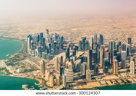DOHA, QATAR - JANUARY 3: An aerial photograph of Doha buildings in Doha, Qatar on January 3, 2015. This northern area is a large urban development and the central business district of Doha, Qatar. - stock photo
