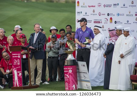 DOHA, QATAR - JANUARY 26: Chris Wood receiving a Rolex watch after winning the US$2.5 million Commercial Bank Qatar Masters in style with an eagle putt on the 18th on January 26, 2013 in Doha Qatar. - stock photo