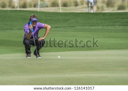 DOHA, QATAR - JANUARY 26: Victor Dubuisson lines up his putt on the 9th hole during the US$2.5 million Commercial Bank Qatar Masters on January 26, 2013 in Doha Qatar. - stock photo