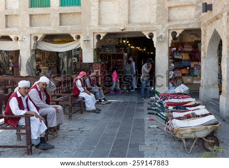 DOHA, QATAR - MARCH 8, 2015: Porters with their barrows await work outside part of the imposing Souq Waqif tourist attraction - stock photo