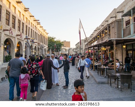 DOHA, QATAR - MARCH 18, 2015: Souq Waqif is a main marketplace and a popular tourist attraction selling traditional garments, spices, handicrafts, and souvenirs. - stock photo