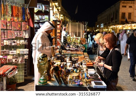 DOHA, QATAR - March 20 2014: Souq Waqif is a main marketplace selling traditional garments, spices, handicrafts, and souvenirs. - stock photo