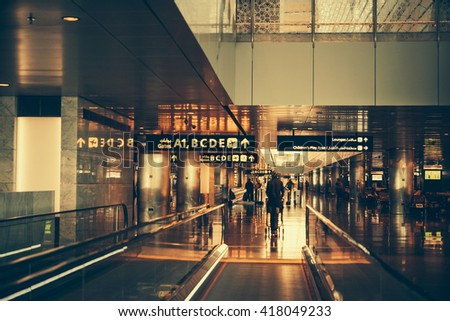 DOHA, QATAR - MARCH 1, 2016: View of Hamad International Airport in Doha, Qatar. Toned picture - stock photo