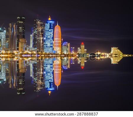 Doha skyline night scene - The Capital City of Qatar - stock photo