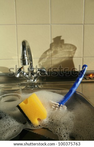 doing the dishes cleaning dirty dishes ........... - stock photo