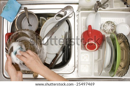 doing the dishes - view from the top - stock photo