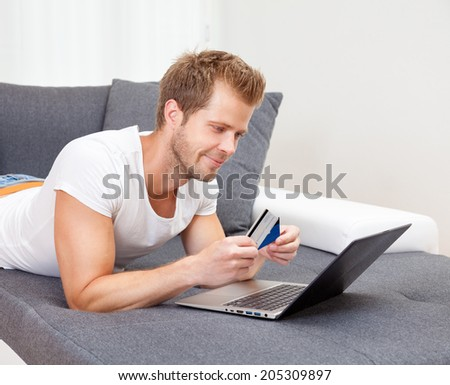 Doing the online shopping from the comfort of your home - stock photo
