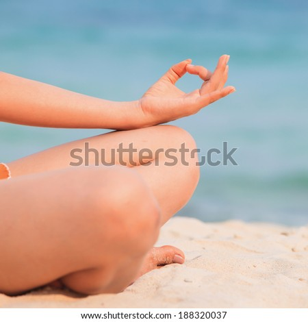 doing yoga exercise with ocean view - stock photo