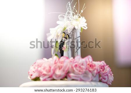 Doll Lovers on wedding cake - stock photo