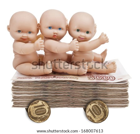 Doll rolling on a cart of money - stock photo
