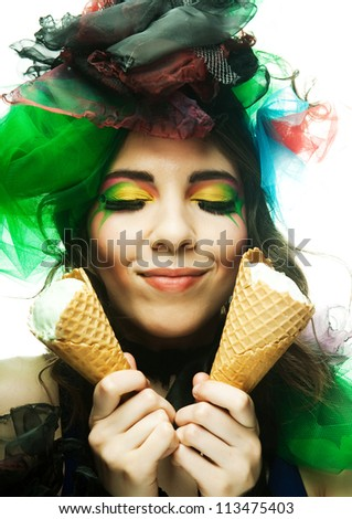 Doll with ice-cream. Creative make-up. - stock photo