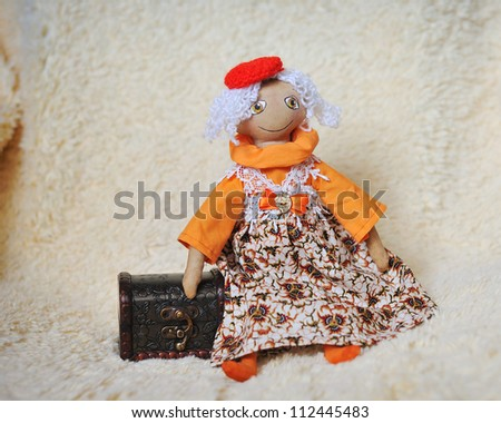 doll with white hair to a red cap with a chest - stock photo