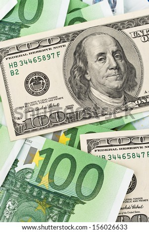dollar and euro banknotes. euro dollar symbol differences - stock photo