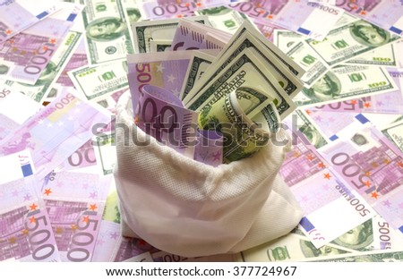 dollar and euro bills in a white bag - stock photo