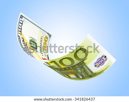 Dollar and euro in a single bill on blue background - stock photo