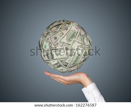 Dollar ball in the hands of business - stock photo