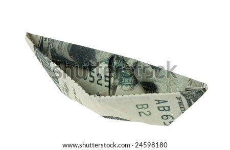 Dollar banknote folded as a boat, business concept. Clipping path included. - stock photo