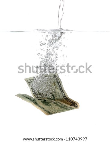 Dollar banknote in water and bubbles - stock photo