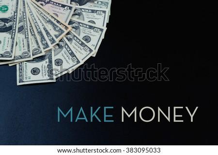 Dollar banknotes on black background - stock photo