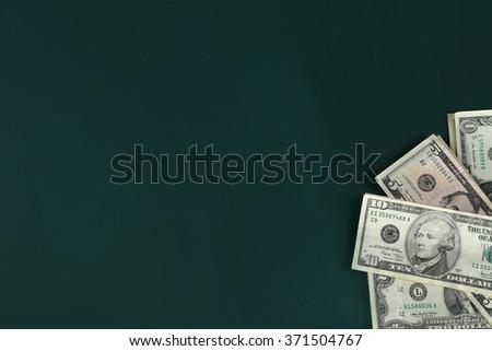 Dollar banknotes on dark background - stock photo