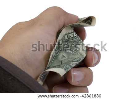 Dollar bill being crushed by hand. - stock photo