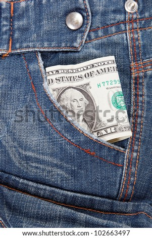 Dollar bill in his pocket jeans. - stock photo