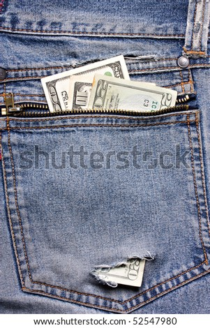 dollar bill in pocket with hole - stock photo