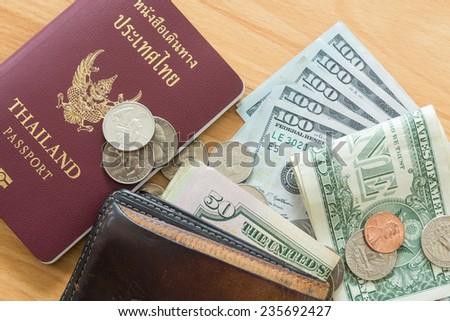 dollar bills and coins wallet passport - stock photo